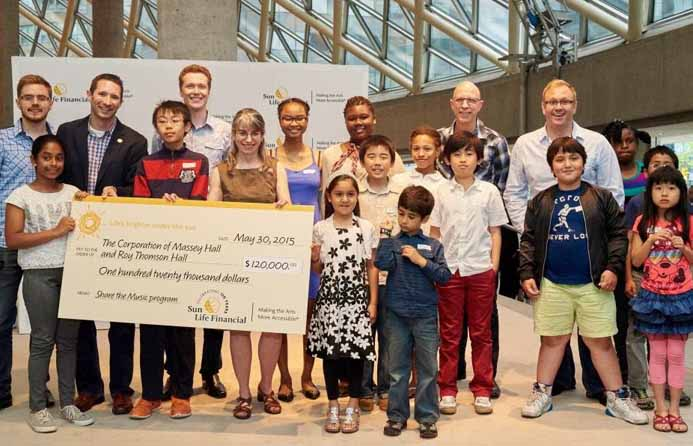 Sun Life Financial presents a cheque for the Share the Music program to Massey Hall and Roy Thomson Hall